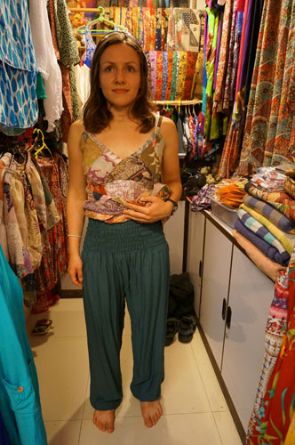 Trying outfits in Ubud market
